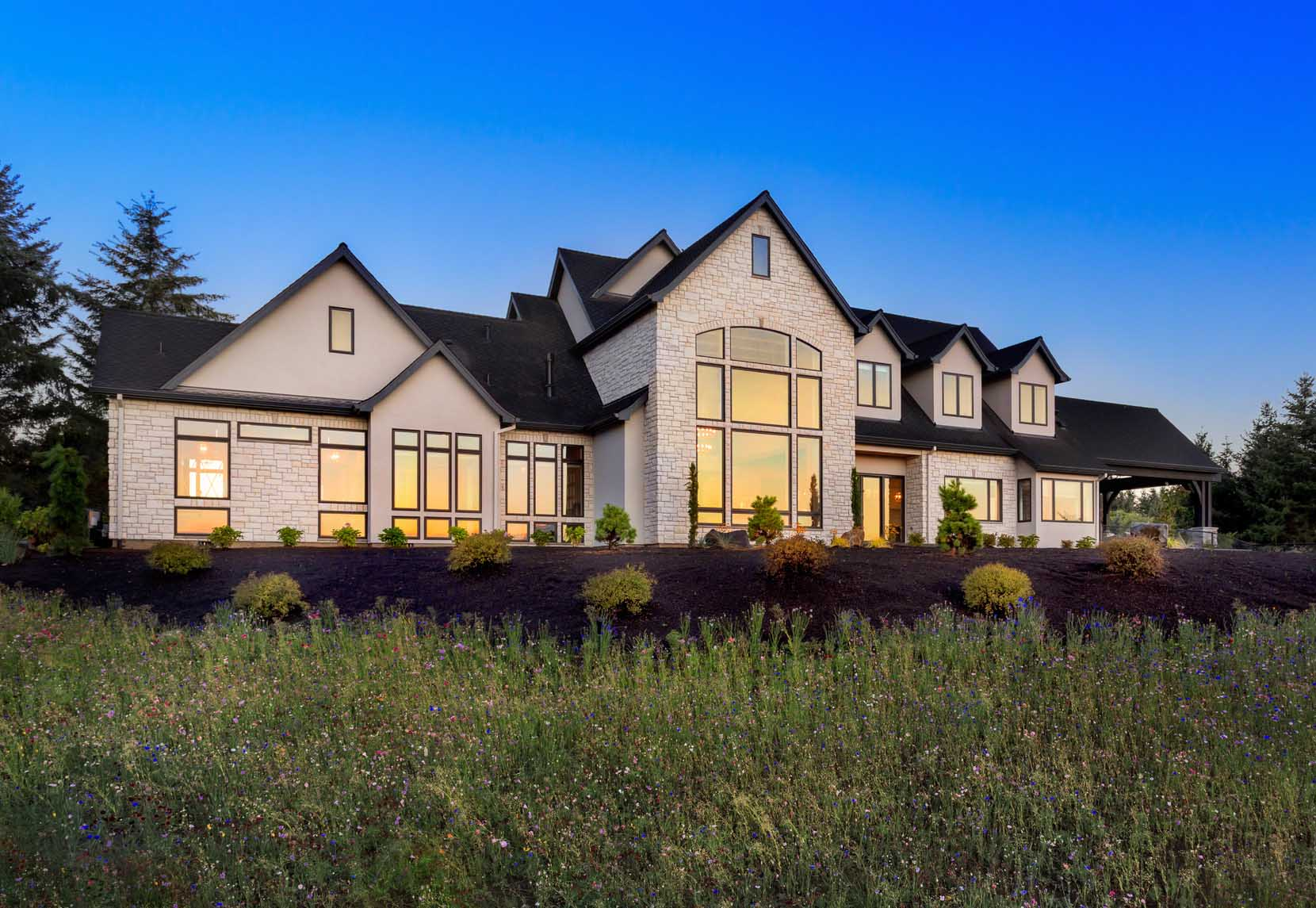 Beautiful home exterior at night for Luxury home windows